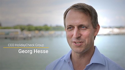 Videostill von Georg Hesse, CEO HolidayCheck Group (Referenzen videoredaktion.de)
